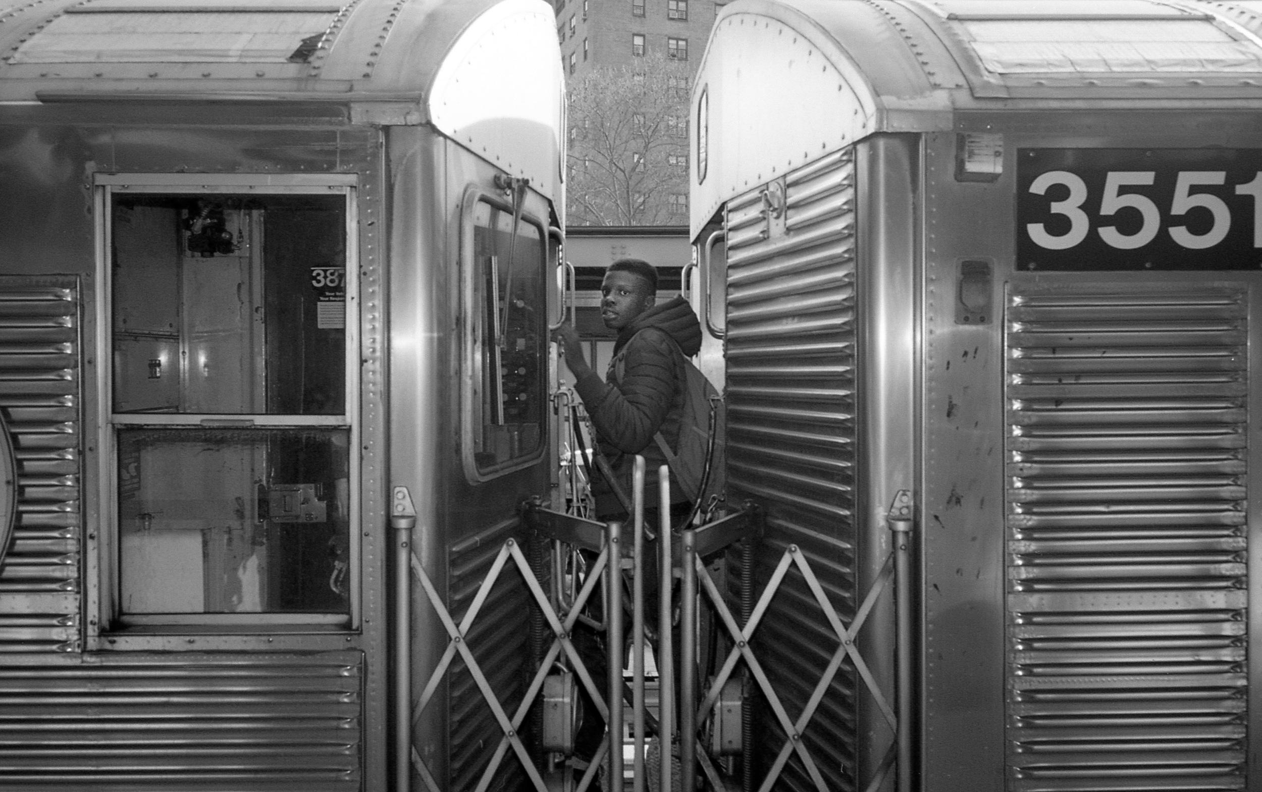 black kid changes trains.jpg