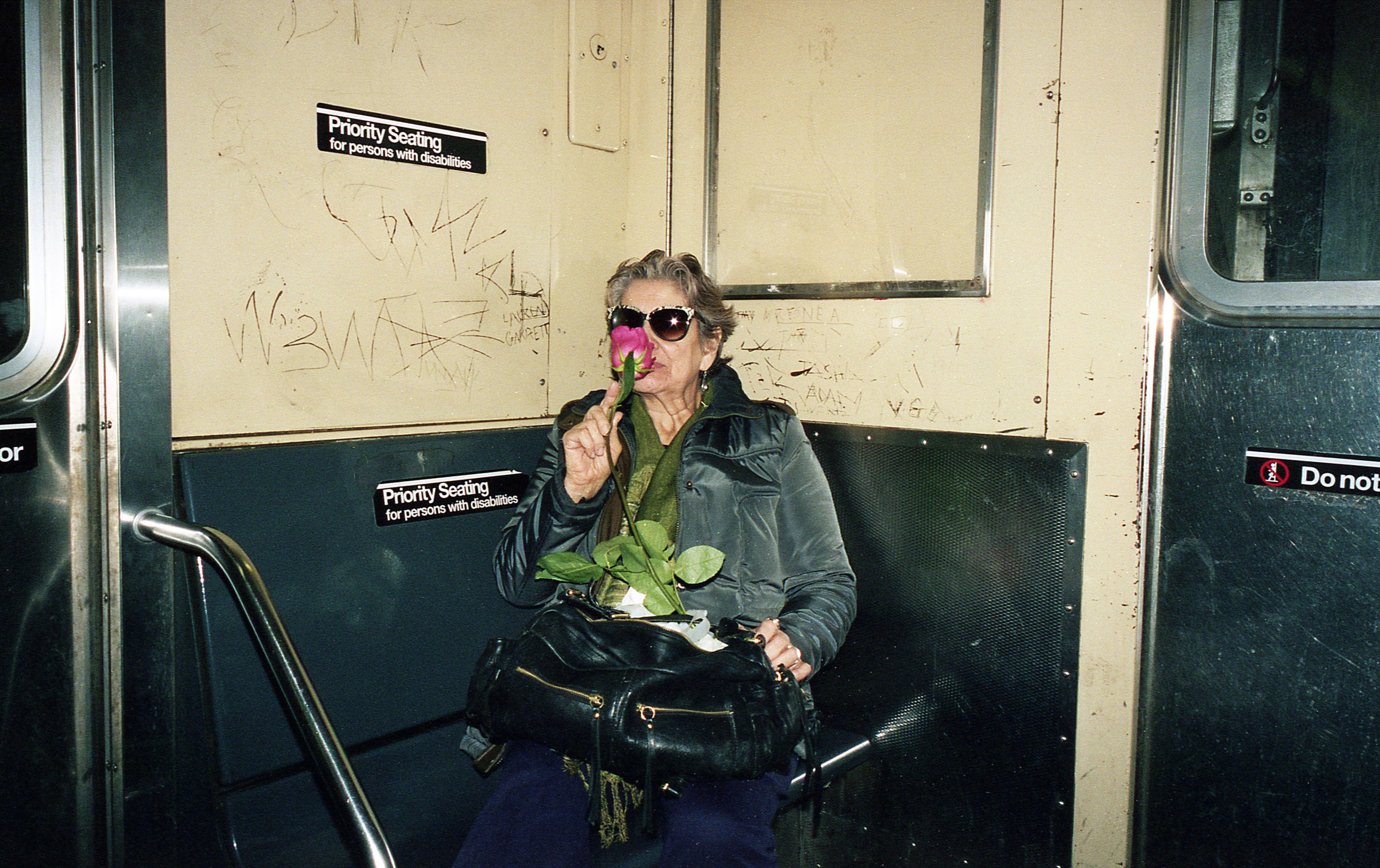 woman smelling rose on train 1.jpg