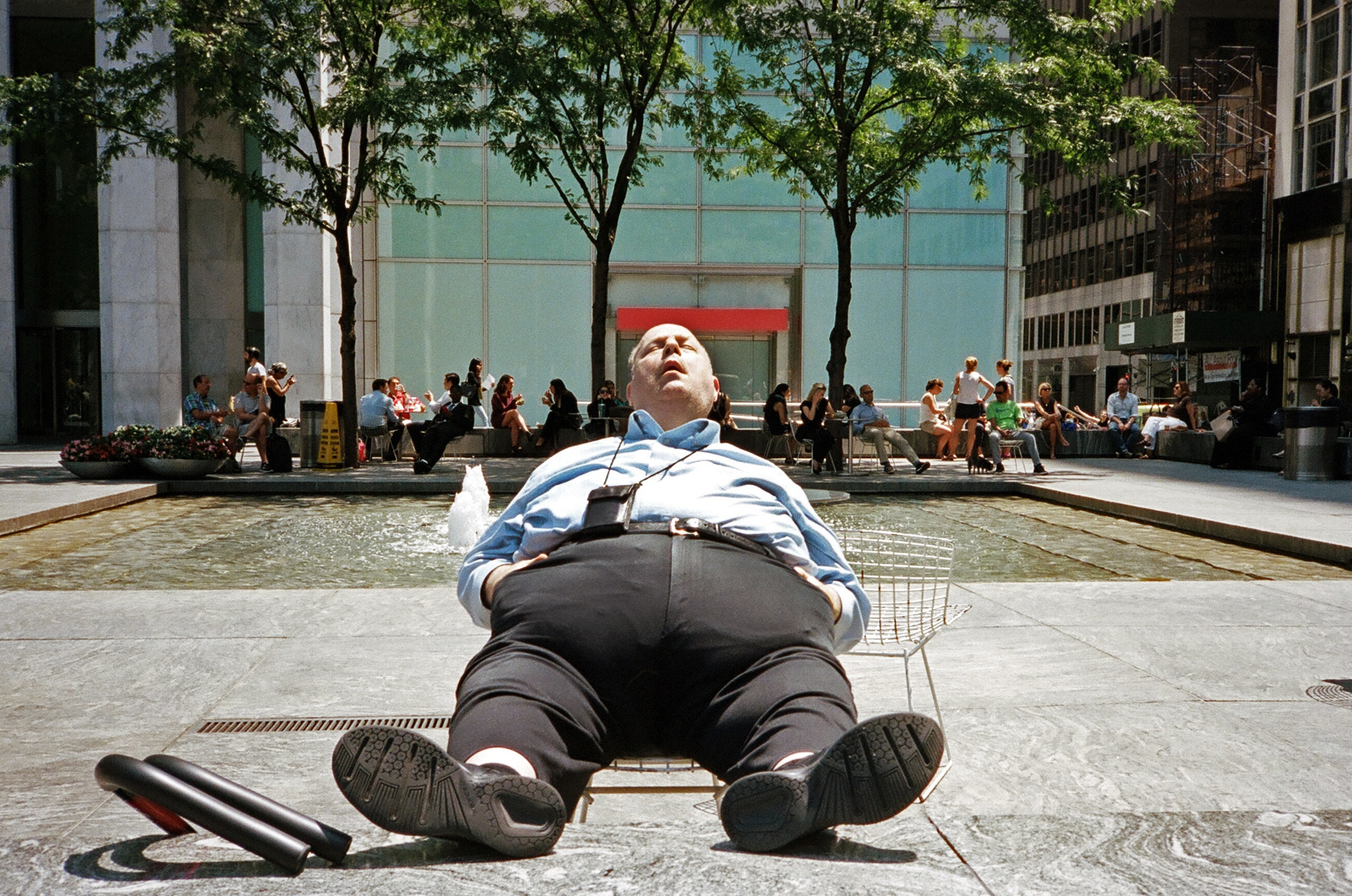 fat man sleeping columbus circle 1.jpg