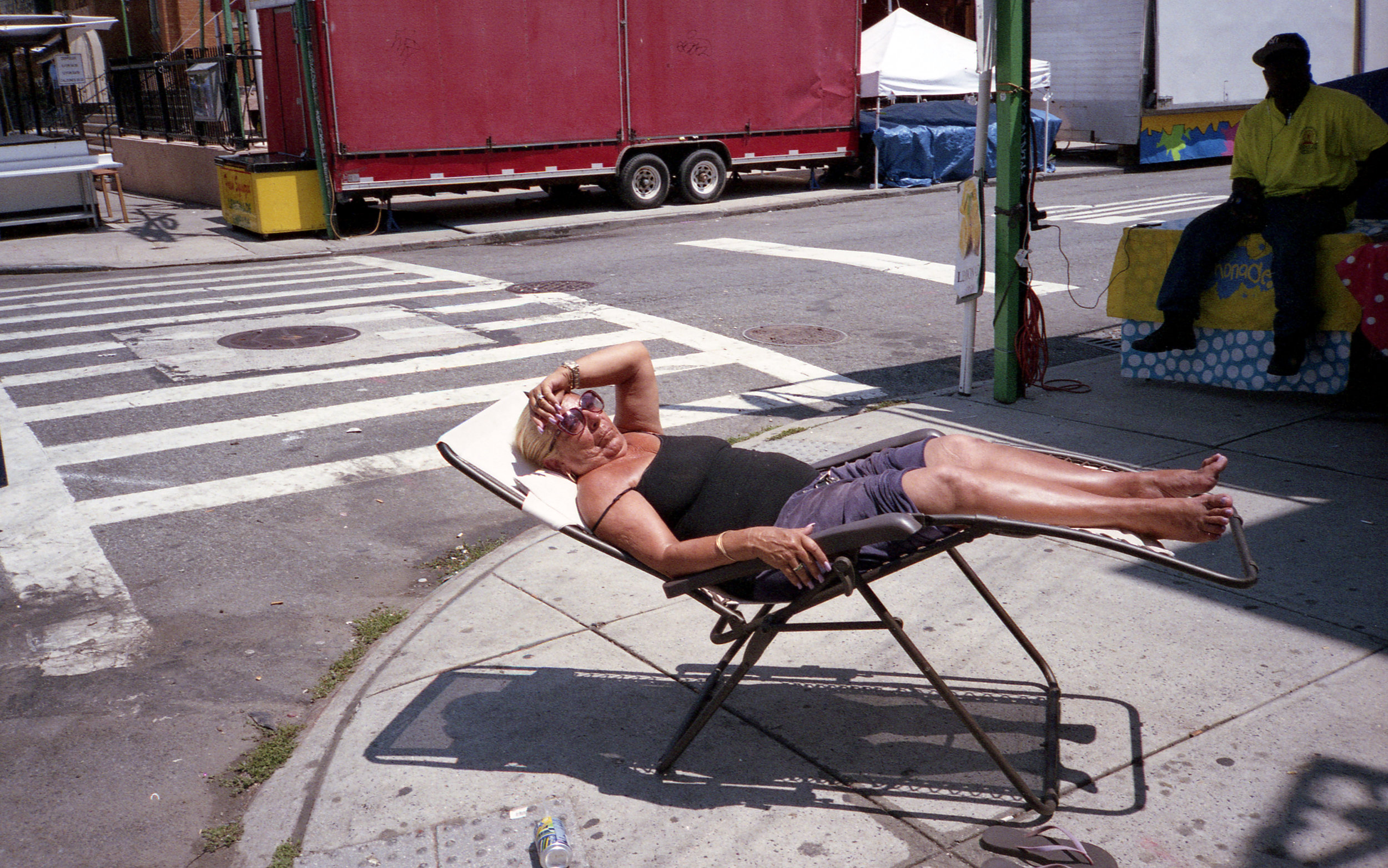 woman on lawnchair sidewalk.jpg