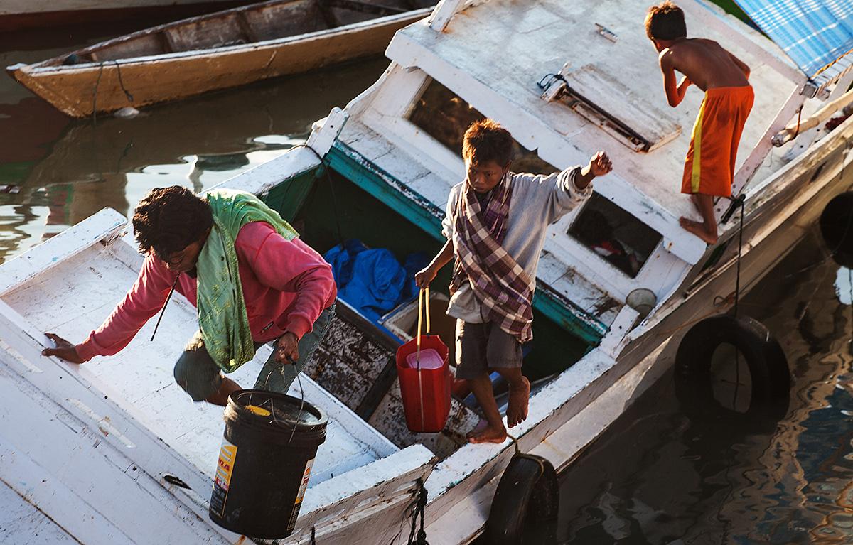 kids using a boat as a walkway
