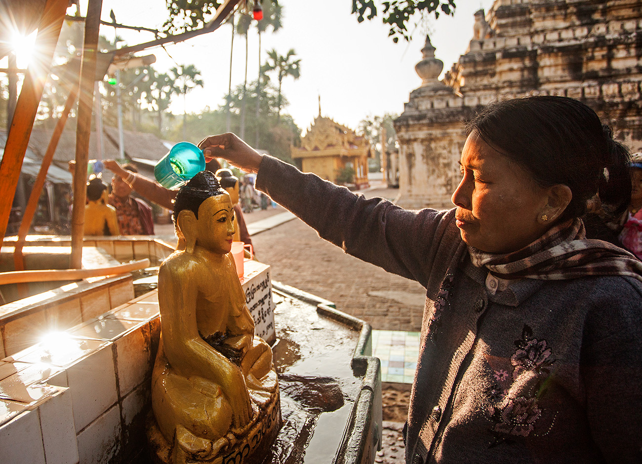 people pour water on the heads of the buddhas for each day of the week