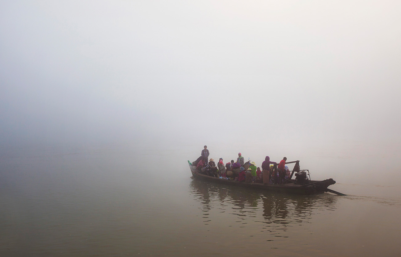 Public boat leaves the shore in Katha