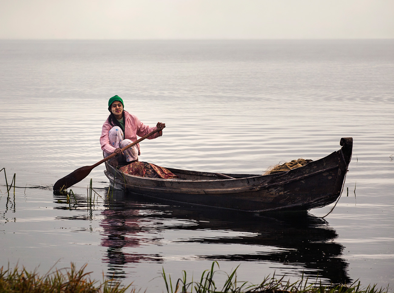 Girl returns from fishing in the morning