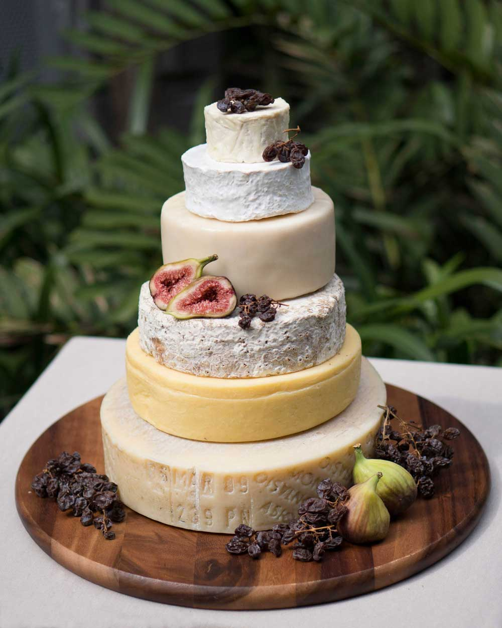 Pricing 2018 (canape sized portions with some to take home)   THREE TIER (serves upto 70 people) $490  Jacks English Club Cheddar 3kg  Enterprize Double Brie 1.5kg  Grub Cashel Irish Blue 1.4kg  FOUR TIER (serves upto 100 people) $680  Berrys Creek Tarwin Blue 3kg  Fromager Daffinois 2kg  Lartisan Fermier 1kg  W/Studd Brillat Savarin 200g  SIX TIER (serves upto 200 people) $850  Heidi Tilsit 4kg  Berrys Creek Tarvin Blue 1.5kg  Tarago Triple Cream 1.5kg  Lartisan Fermier 1kg  Miliwa Brie 500g  Yvd Black Sav Pyramid 110g  All cheese towers come decorated with grapes and served with quince paste and a selection of crackers.  Speak to your event planner about ordering for your wedding day!