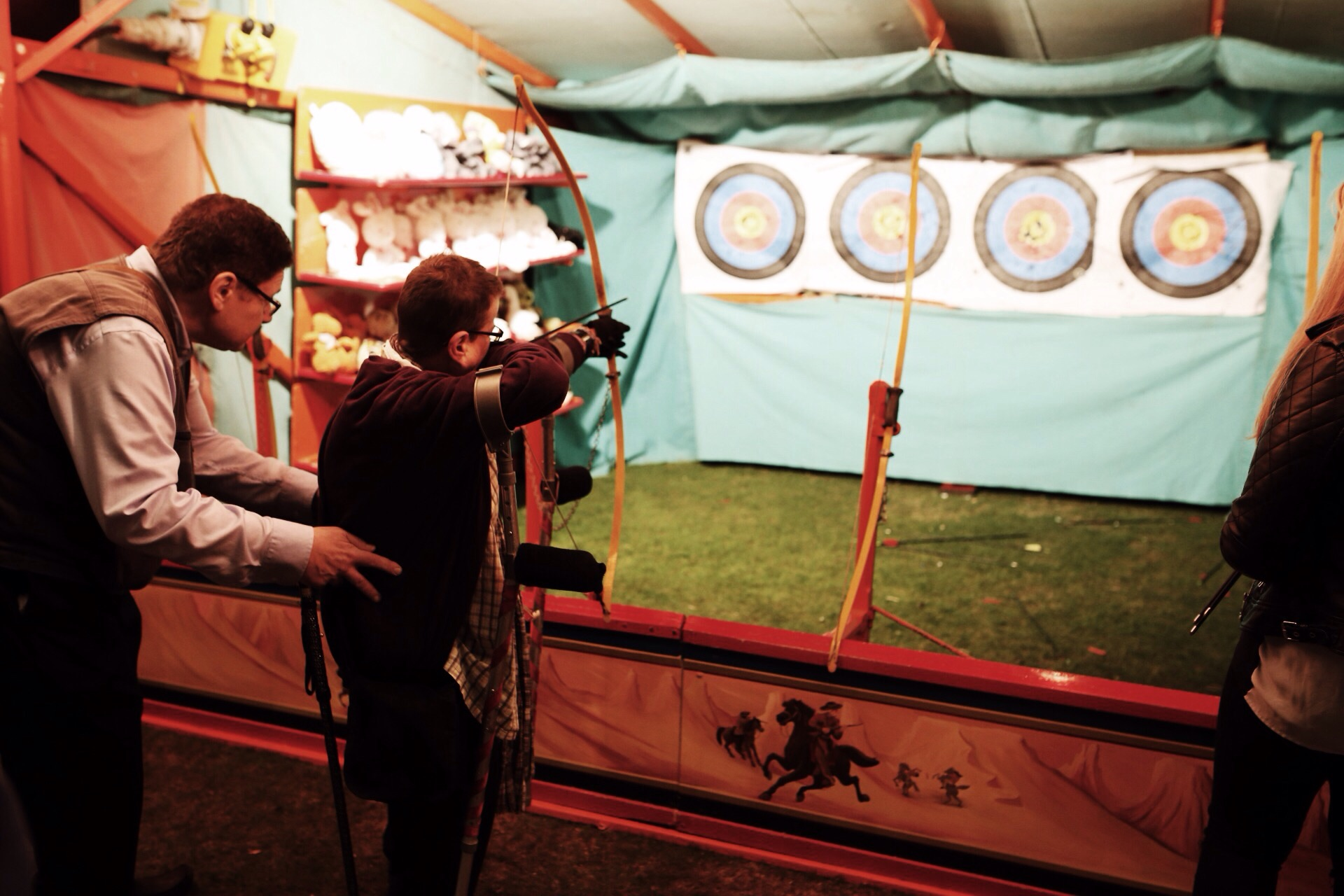 Steam Faire: caught this cute moment of this elderly man helping his partner stay stable as she tried to shoot an arrow at the Faire.