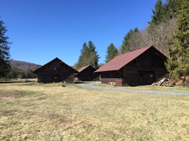 Three deep-eaved barns