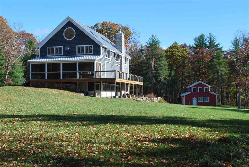 Big Barn house with 4 car garage featuring upstairs yoga studio.