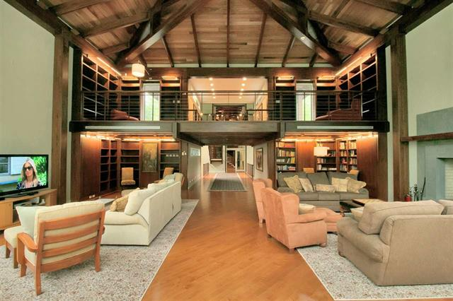 The current owner fully renovated the home in 2005 adding soaring ceilings of tongue and groove reclaimed redwood from NYC water tanks. Master level has private gym, office and custom mahogany cabinetry. There is a roof deck, and three-story elevator.