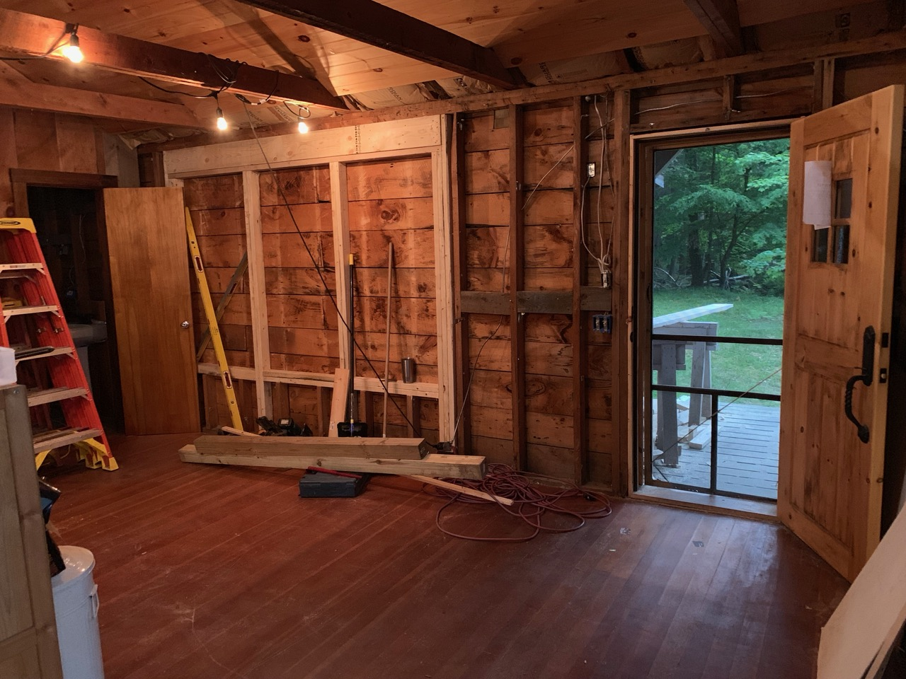 The wall with the bookcases will have windows as shown.