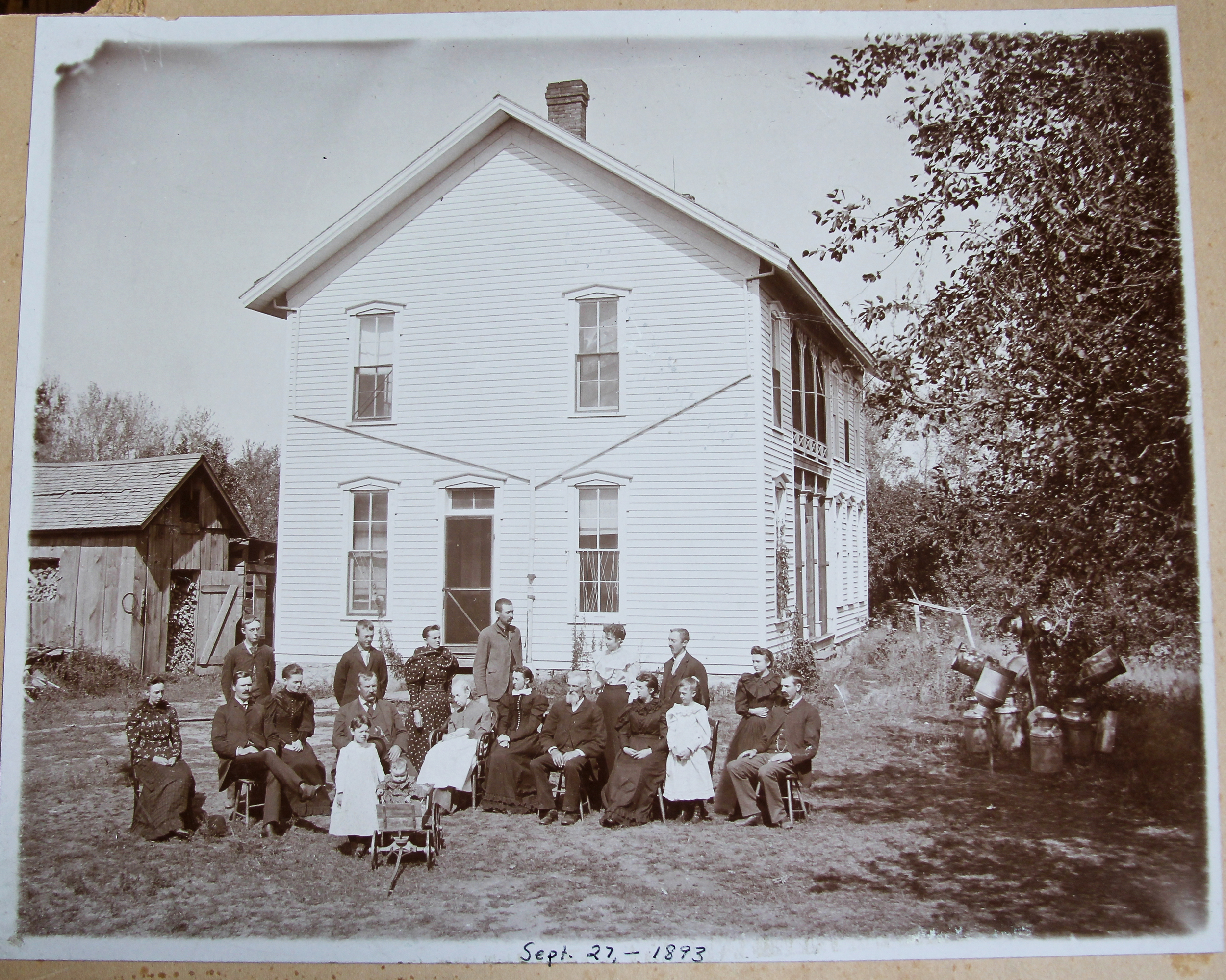 The farm in 1893. Jane Rundles (1st generation) is sitting front and center, James & Ella Rundles (2nd generation) standing behind Jane. Other family members surround them. In 1949 this house was replaced by the brick house currently standing, by William and Mary Grupp (3rd generation).