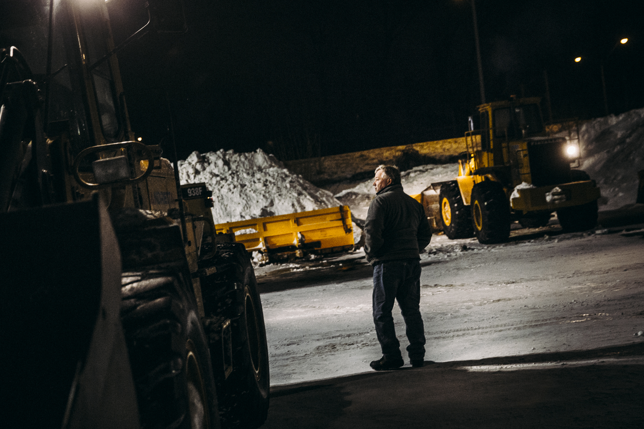 John Riley, who managed the night's project for OnSite, surveys the Solar St. parking lot before work began late Thursday night outside of Destiny USA. Crews began working at 11 p.m. and will continue to work until 8 a.m.