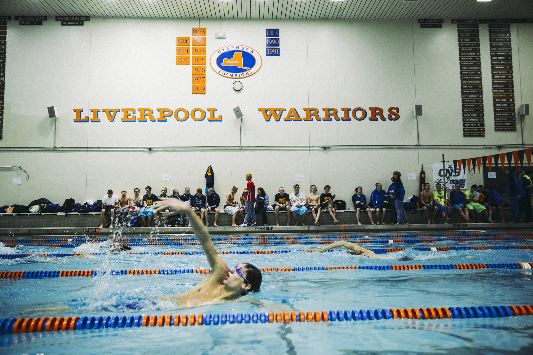Jacob Fauret, a senior from Watertown swims warmup laps during a break at the Section 3 Boys A Championship Meet at Liverpool High School. Watertown dominated the first half of the meet, and placed second on the evening.