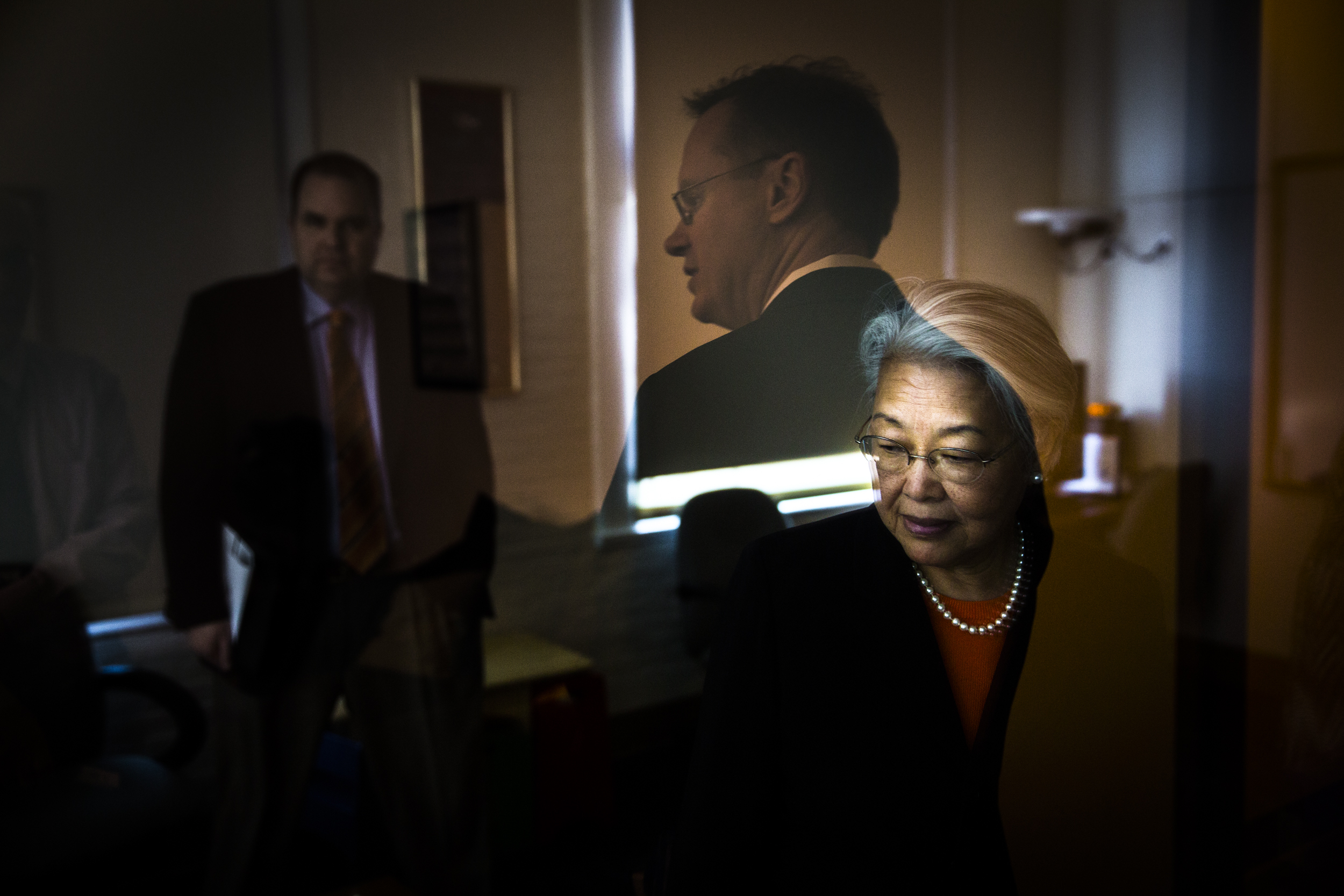 Ruth Chen, the wife of Syracuse University's Chancellor Kent Syverud, looks around a counseling room while Syverud tours an observation room on the opposite side of a two way mirror. The two were being given a tour of Peck Hall, home to the Marriage and Family Therapy program in the David B. Falk College of Sport and Human Dynamics.