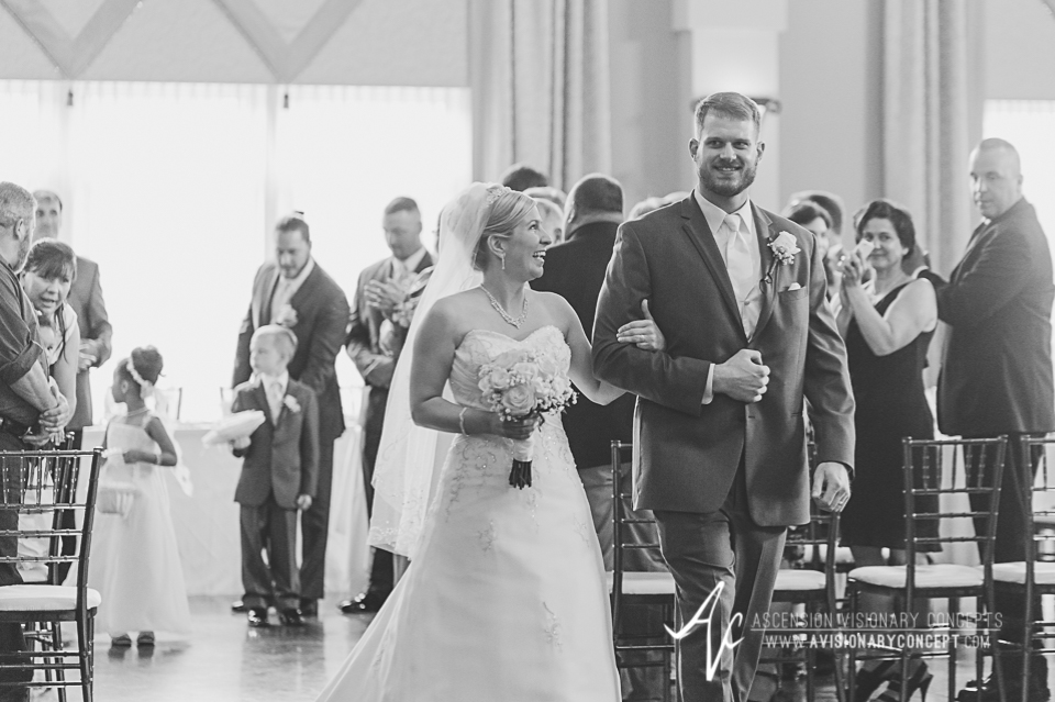 Buffalo Wedding Photography Avanti Mansion 33 Bride Groom Ceremony Exit.jpg