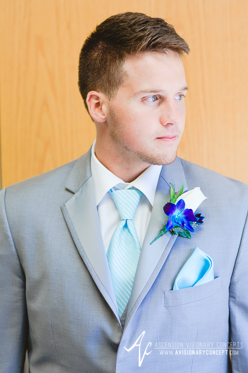 Rochester Wedding Photography Plantation Party House Spencerport Wedding 010 - Groom Grey Suit Turquoise Boutonniere.jpg