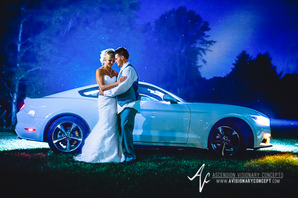 Rochester Wedding Photography Plantation Party House Spencerport Wedding 066 - Bride Groom Sports Car Night Shot.jpg