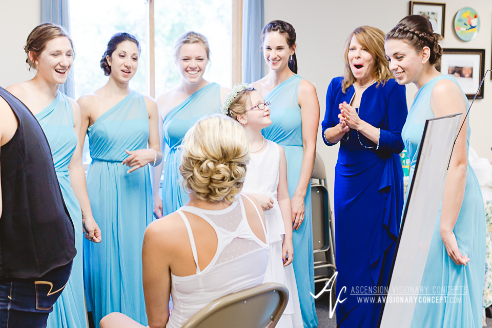 Rochester Wedding Photography Plantation Party House Spencerport Wedding 005 - Beautiful Bride Blonde Blue Eyes Looking in Mirror Hair Makeup.jpg