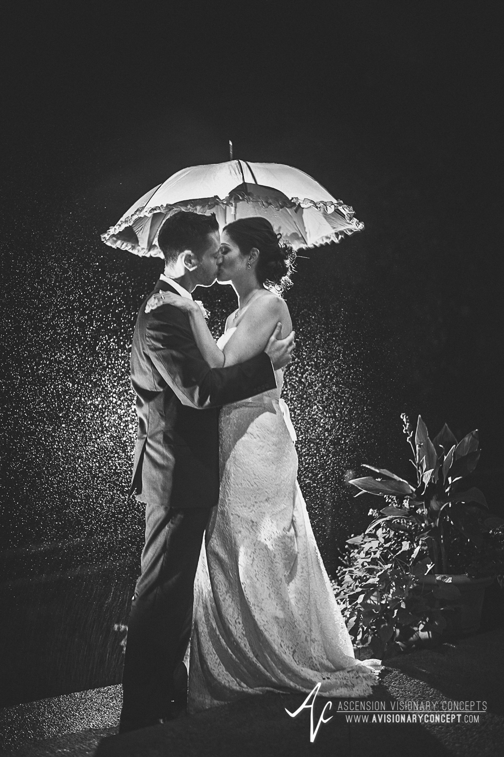 Buffalo Wedding Photography Spring Lake Winery 082 - Wedding Bride Groom Rainy Day Wedding Umbrella Kiss Backlit B&W Black and White.jpg