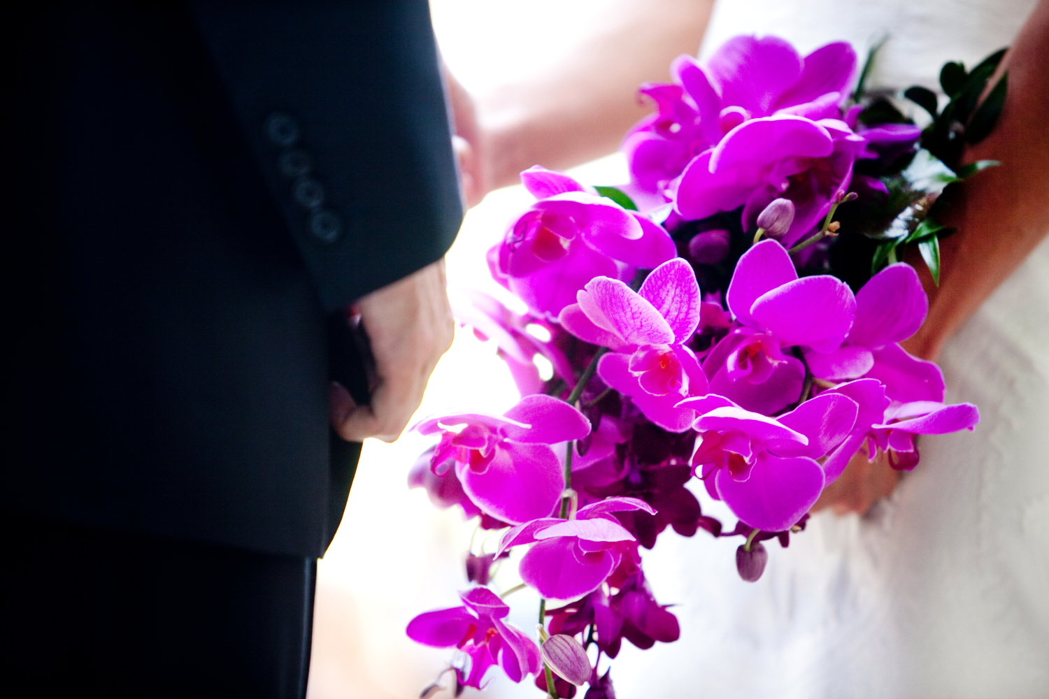 Logan Smith Pollack's bridal bouquet of orchids. Photo by Tracy Turpen.