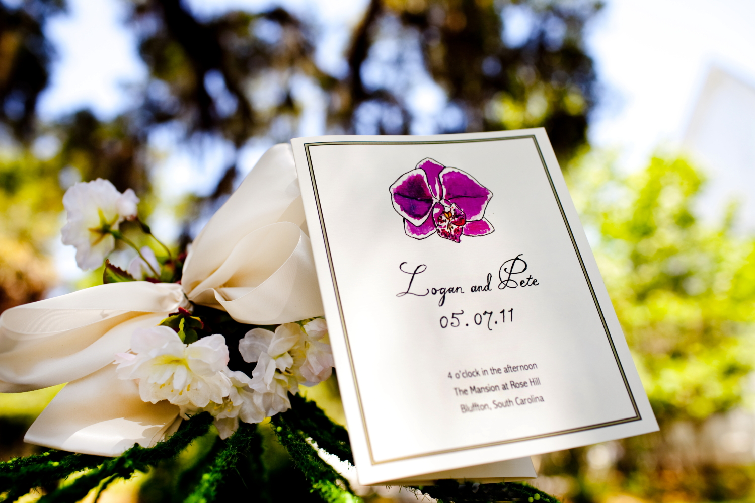 LAURA ANN orchid wedding program for Logan and Pete. Photo by Tracy Turpen.