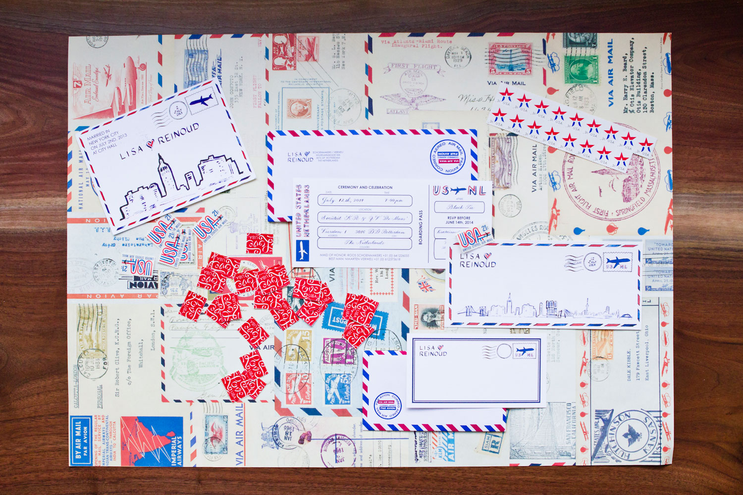 LAURA ANN Airmail inspired wedding stationery suite. The airplane boarding pass invitation design represented the couple's courtship between the Netherlands and New York.