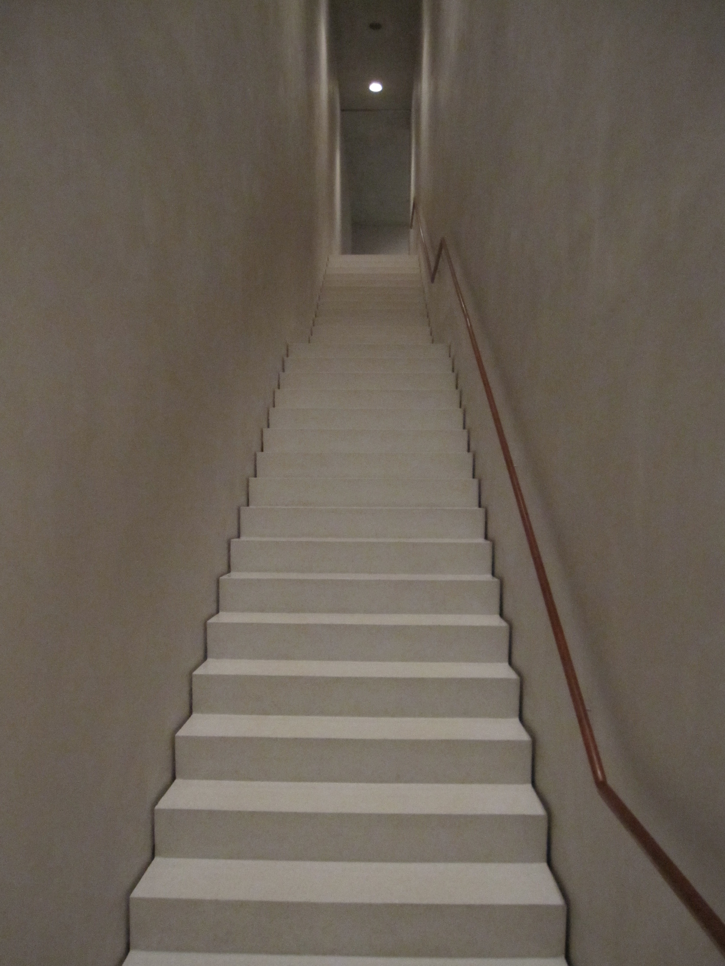 "HERE THE STAIR AND THE WALL ARE SEPARATED BY A 1/2"" REVEAL"