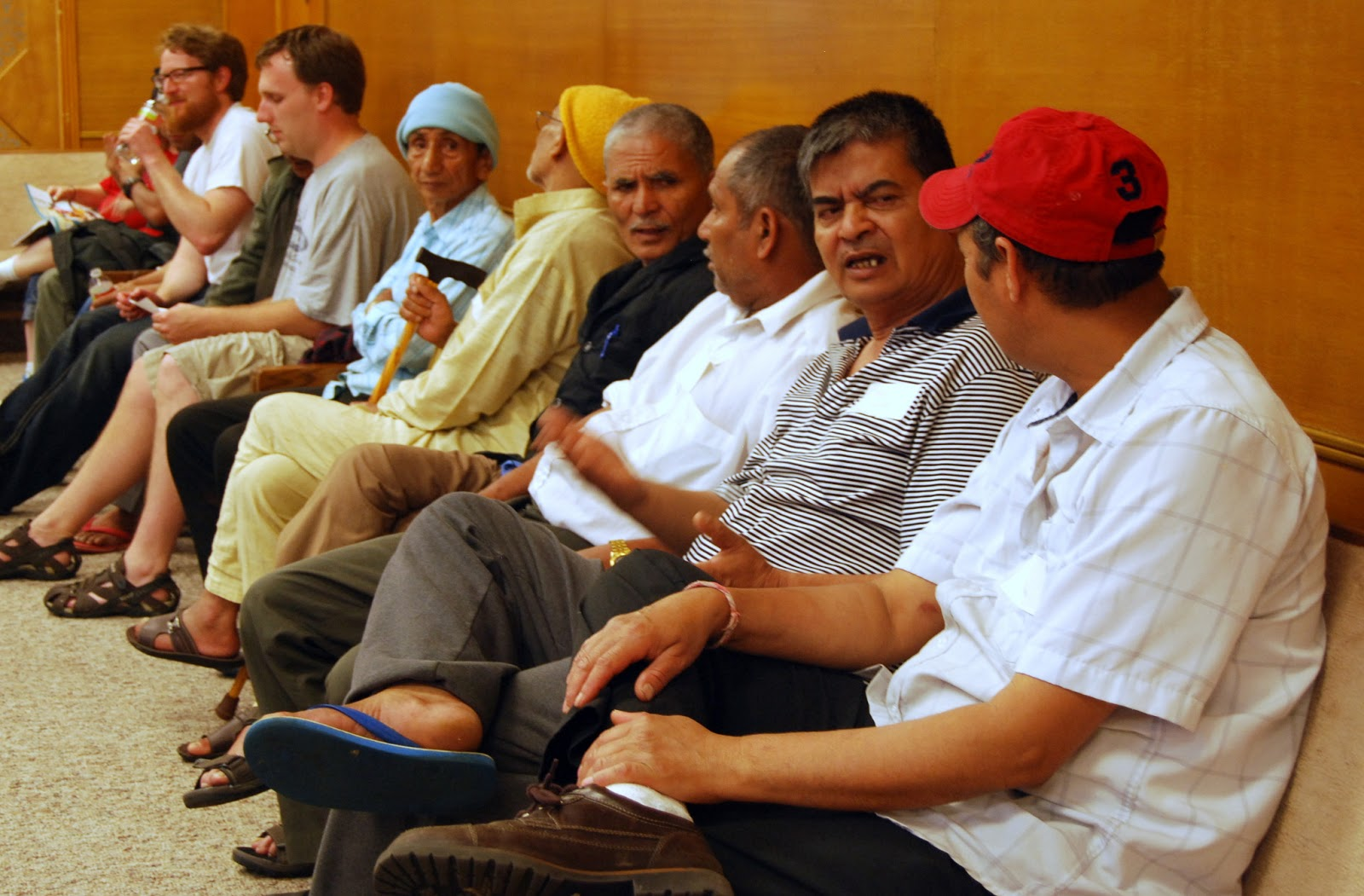 Bhutanese men talk together at the ESL Launch Party last Tuesday night.