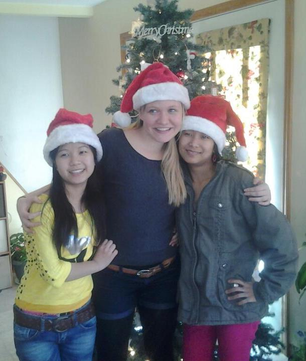 Hannah Hume with two Bhutanese teen girls