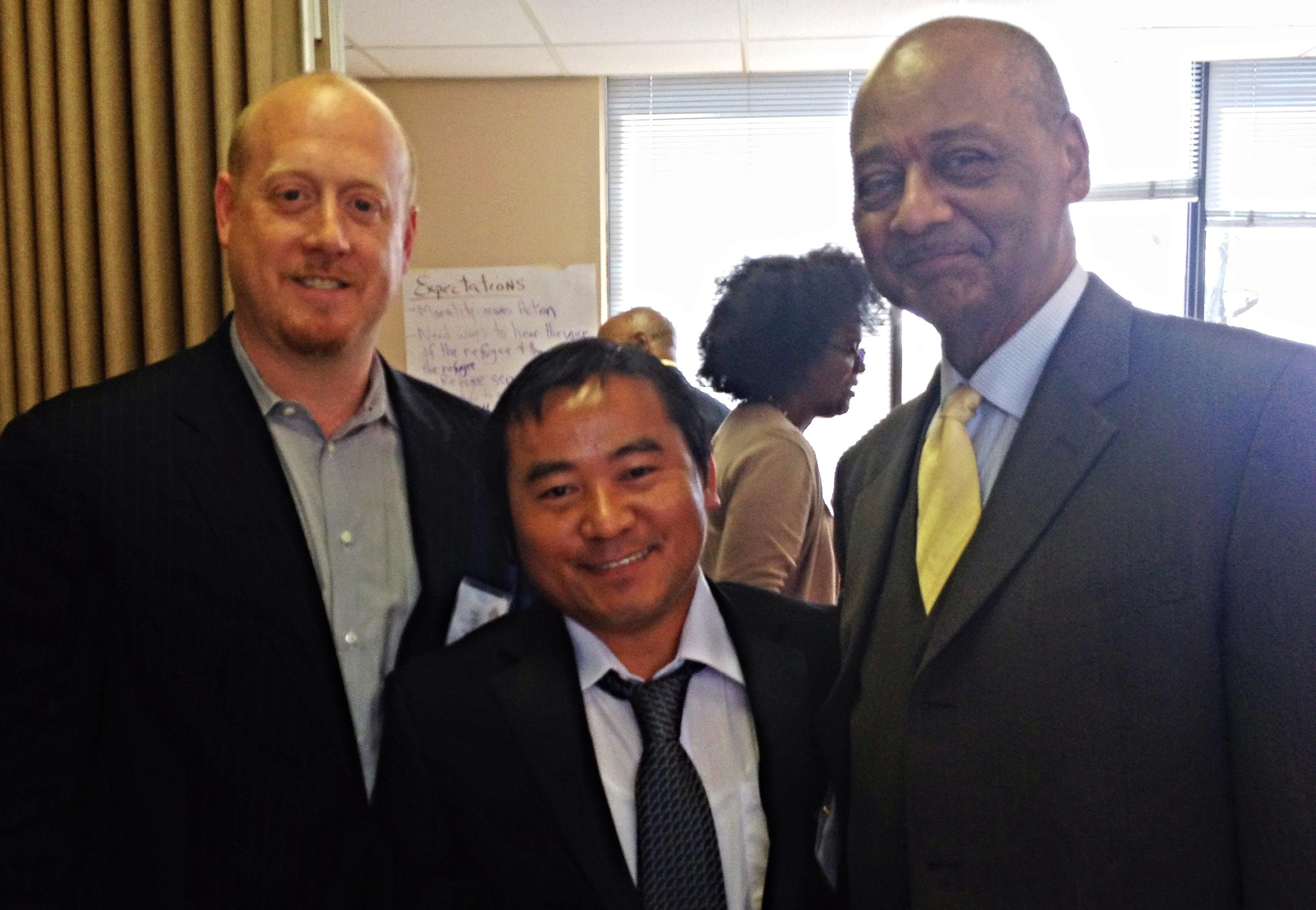 Bhutanese Community Leader Ram Rai (center) with a CNE presenter (right) and Robert L.   Woodson, Sr (left) at the Kansas Community Leadership Enterprise