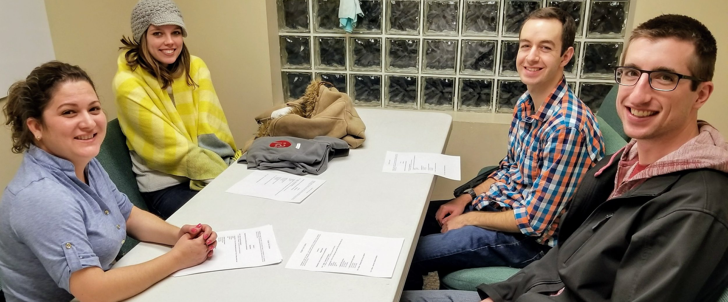 Cody (far right) and Joanna (yellow sweater) participate in a planning session for English Club.