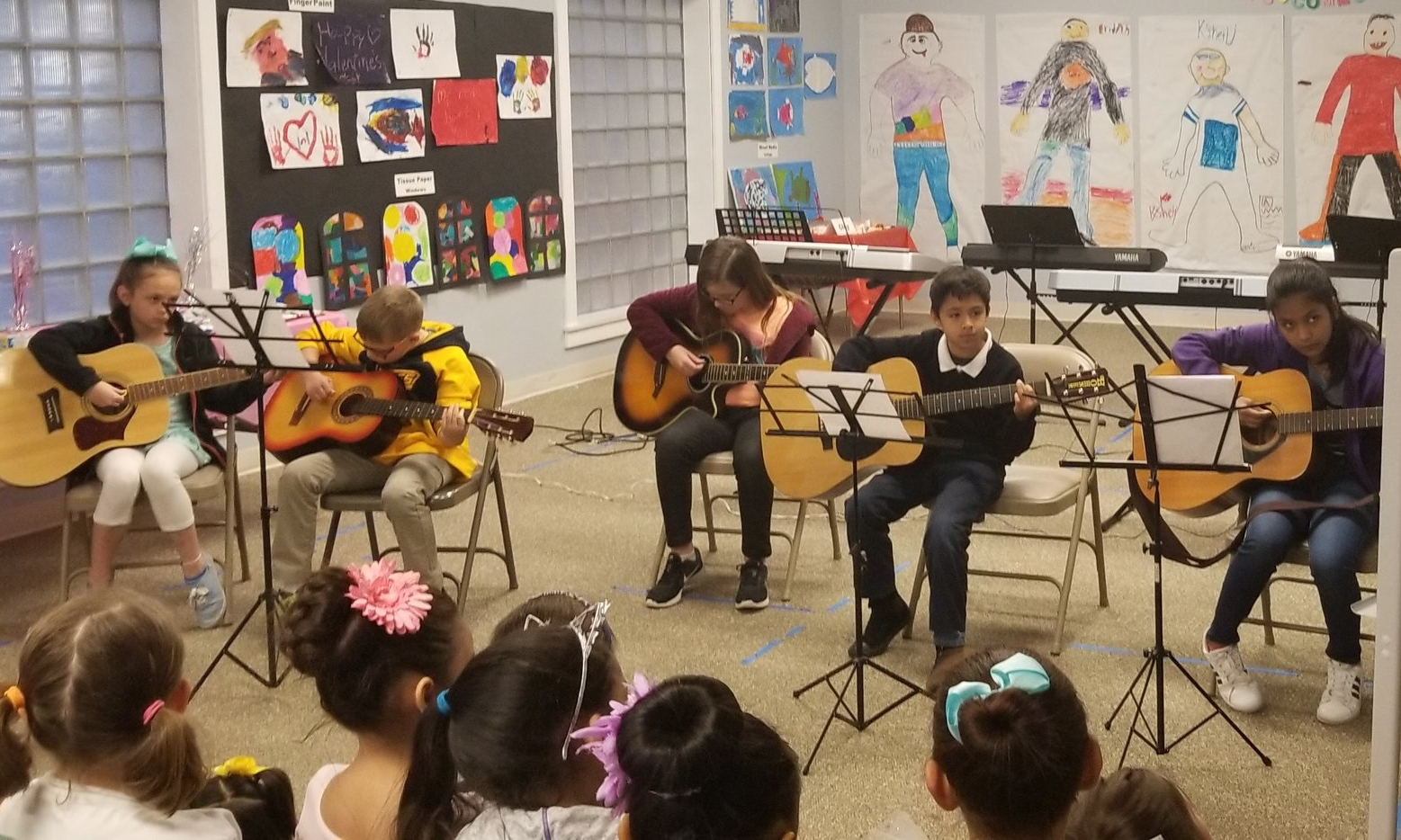 The guitar class performing at the trimester party.