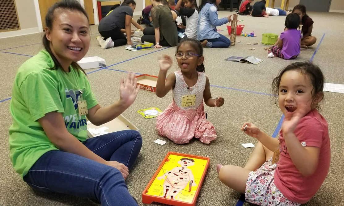 Sunny playing with kids at Refugee Kids Club
