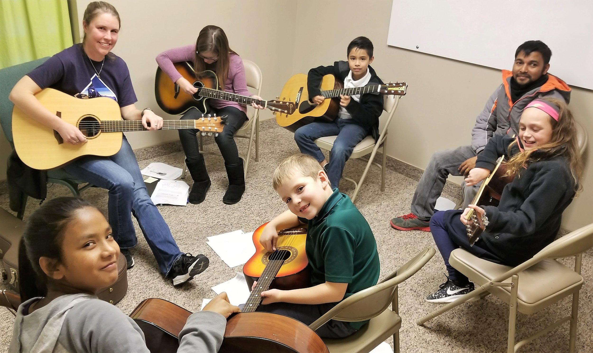 Guitar- Arts Community.jpg