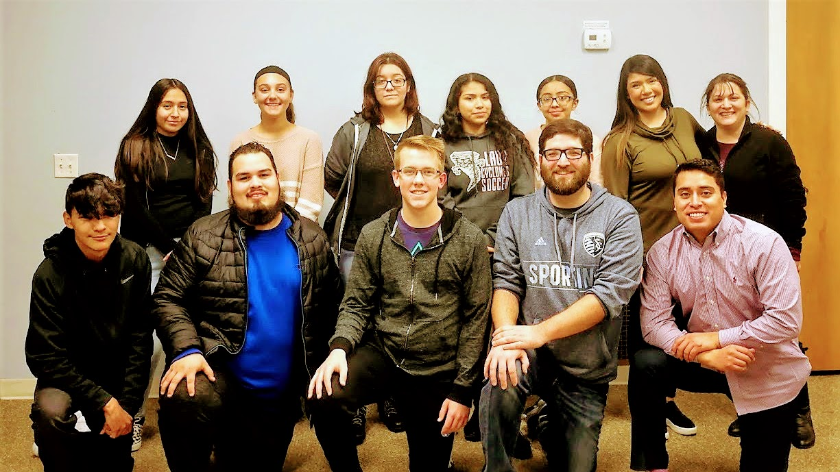 Michael Pollock (second from right on the bottom row) is pictured here with the youth and other volunteers from Teens Adelante.