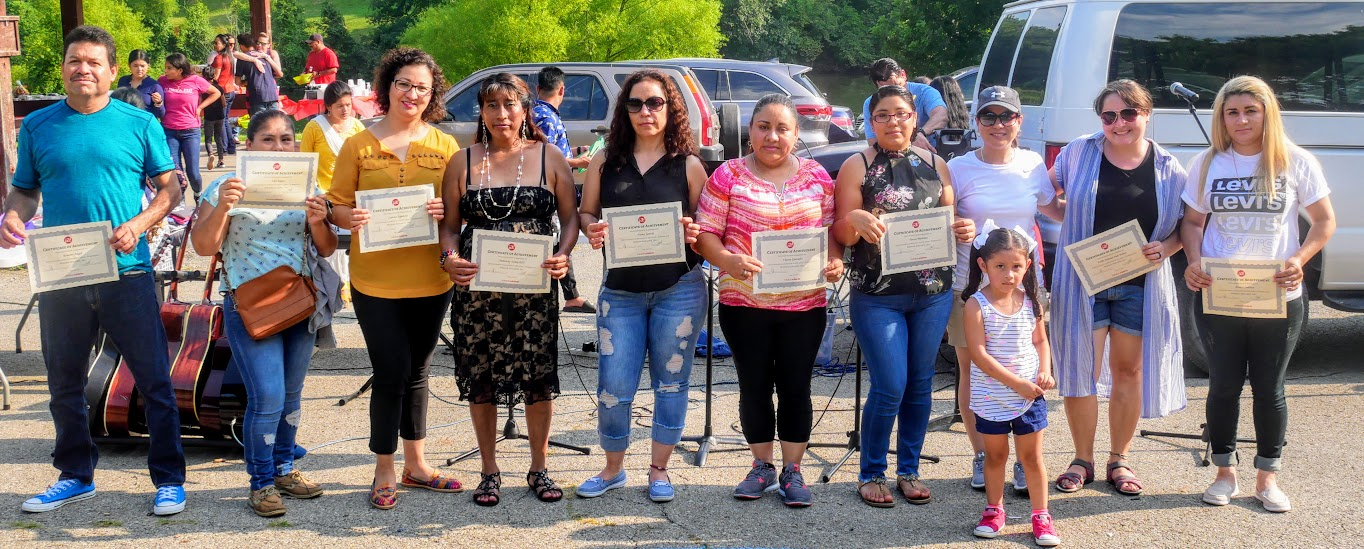 Leidy (second from right) and other ESL Level 1 students receiving their certificate.