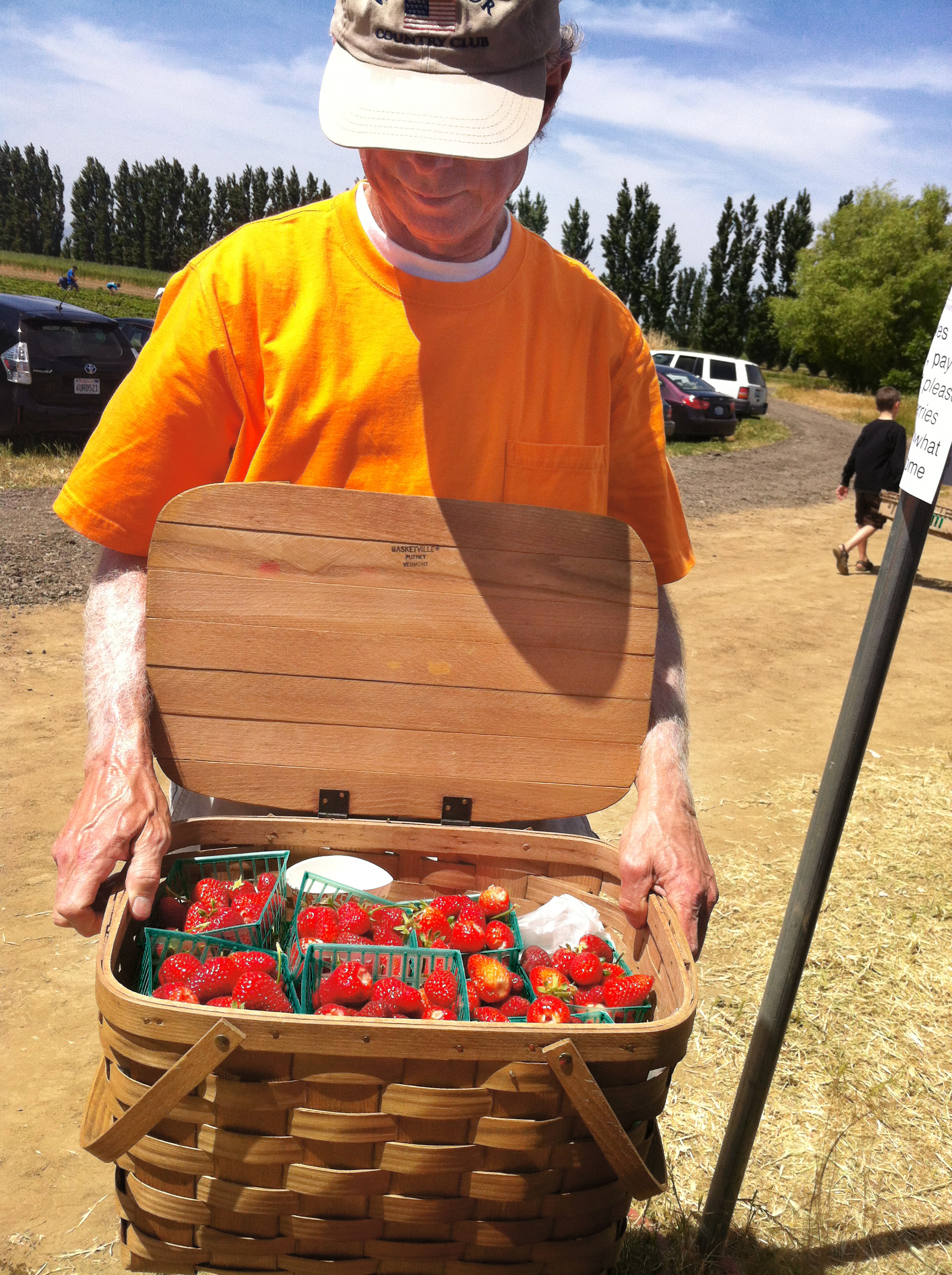 John with his basket full of freshly picked strawberries at an Eatwell Farm Strawberry Day event.