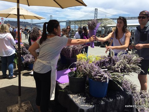 Joyce sells bunches of fresh lavender to Ferry Plaza Farmer's Market customers on Saturday.