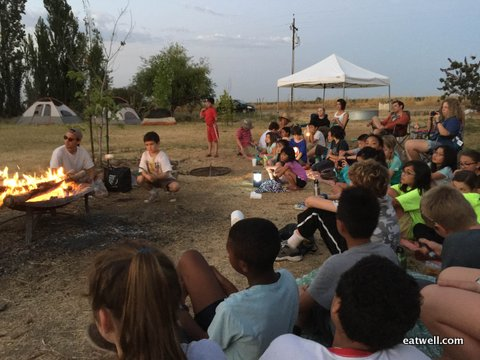 Bay Leaf Kitchen campers relax by the campfire after a day of farm fun.
