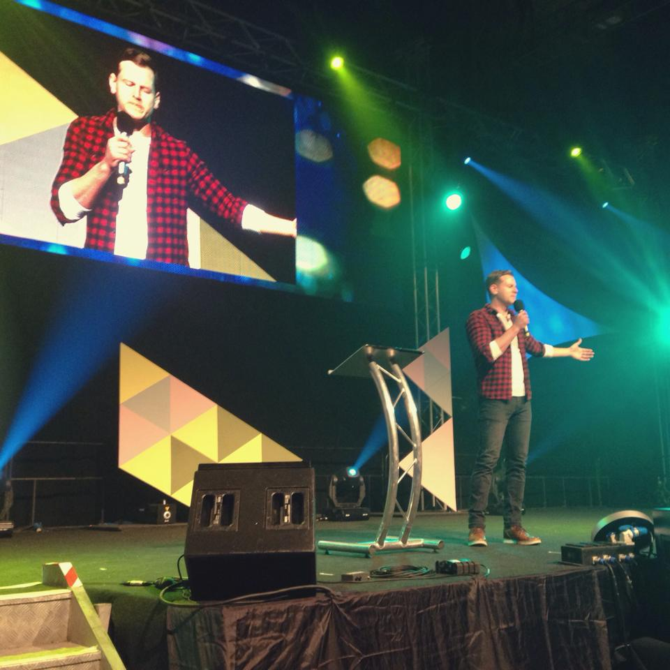 Rob hosting and leading prayer in the Big Top