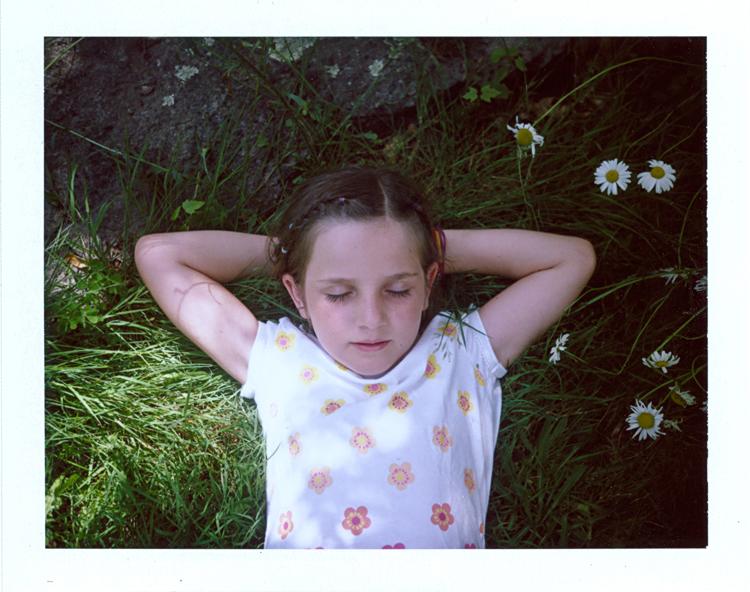 Madelyne laying in grass.jpg