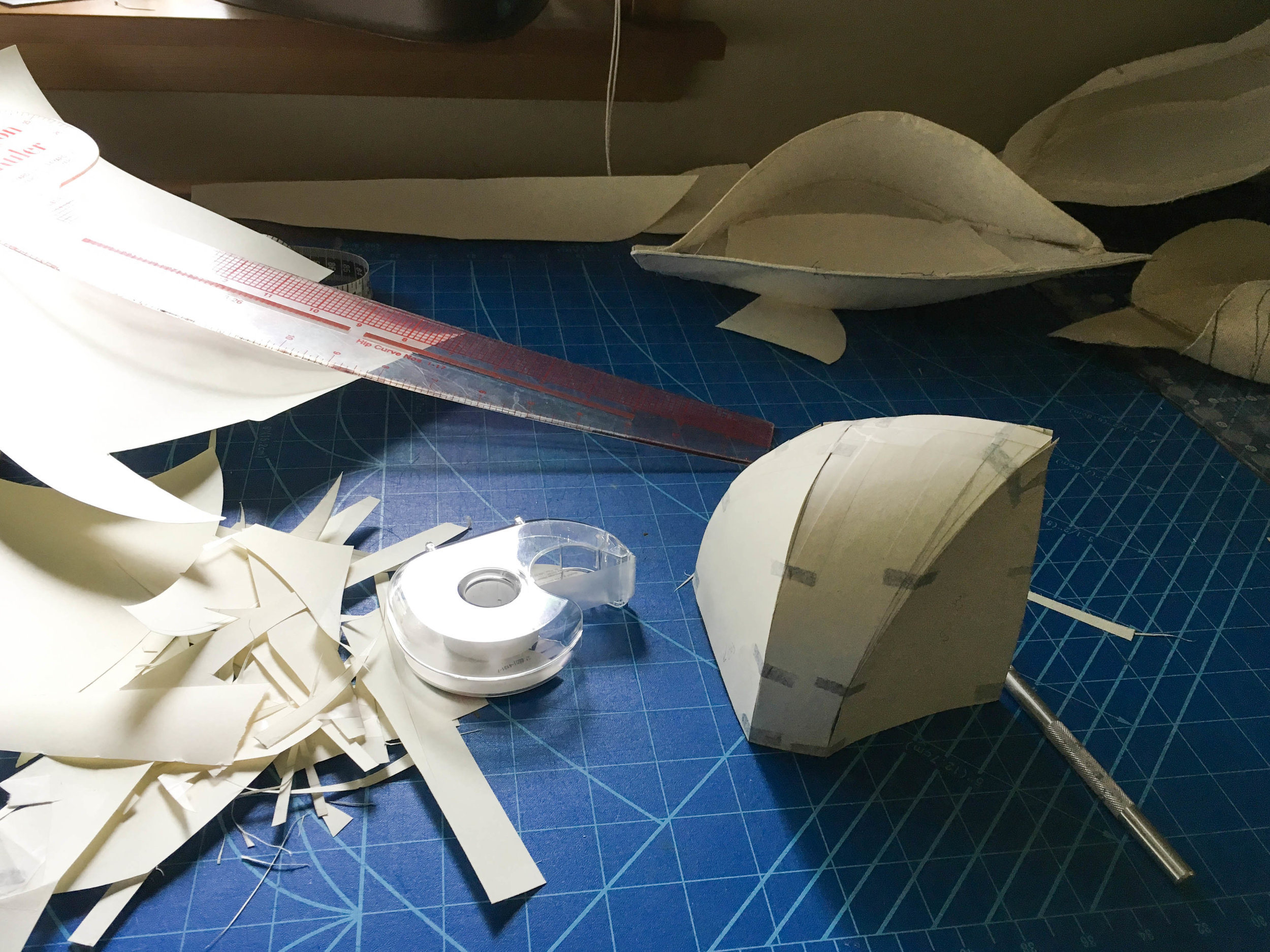 My paper pattern mockups establish curves, seam lengths, and a better understanding of volume.