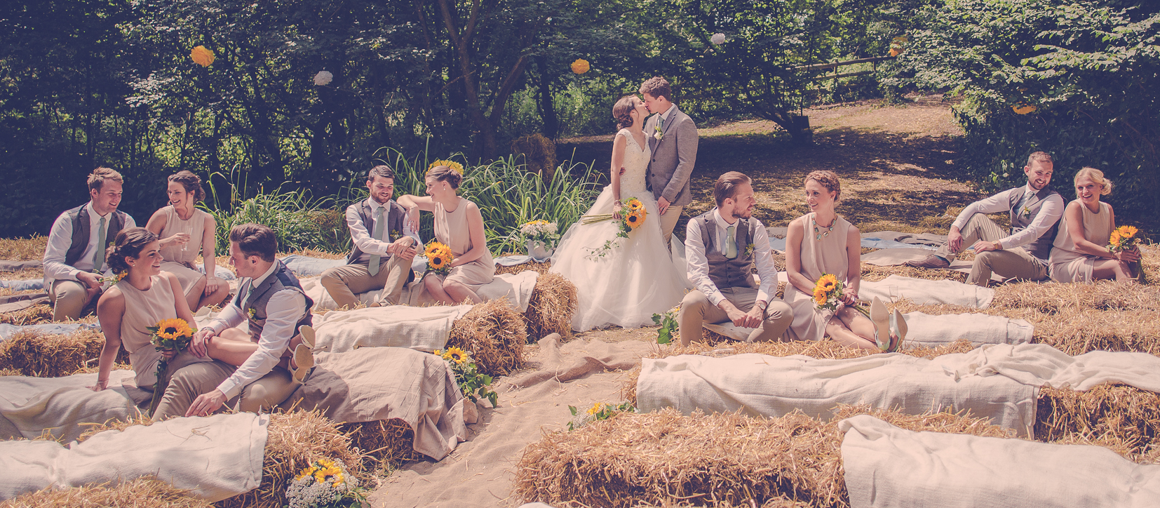 Picture on haybales wedding party
