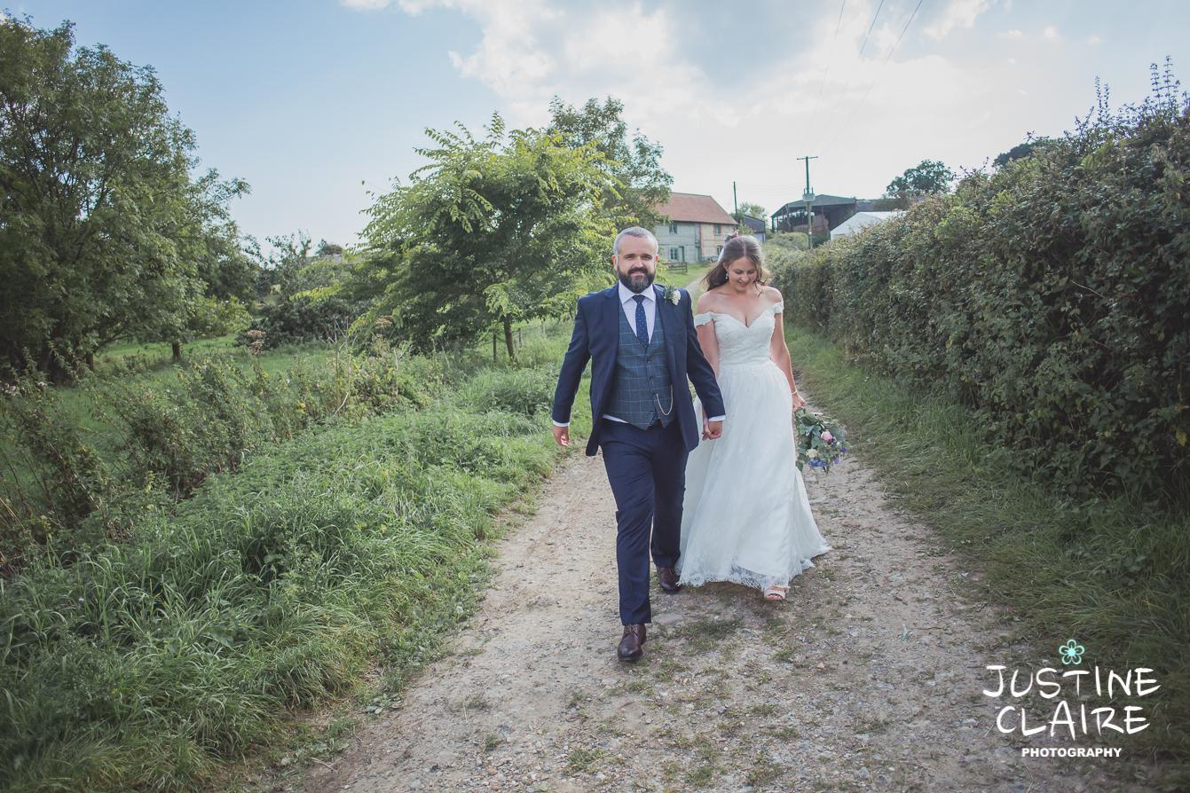 Photographers in Sussex Court Garden Farm Vineyard Barn Wedding Ditchling-117.jpg
