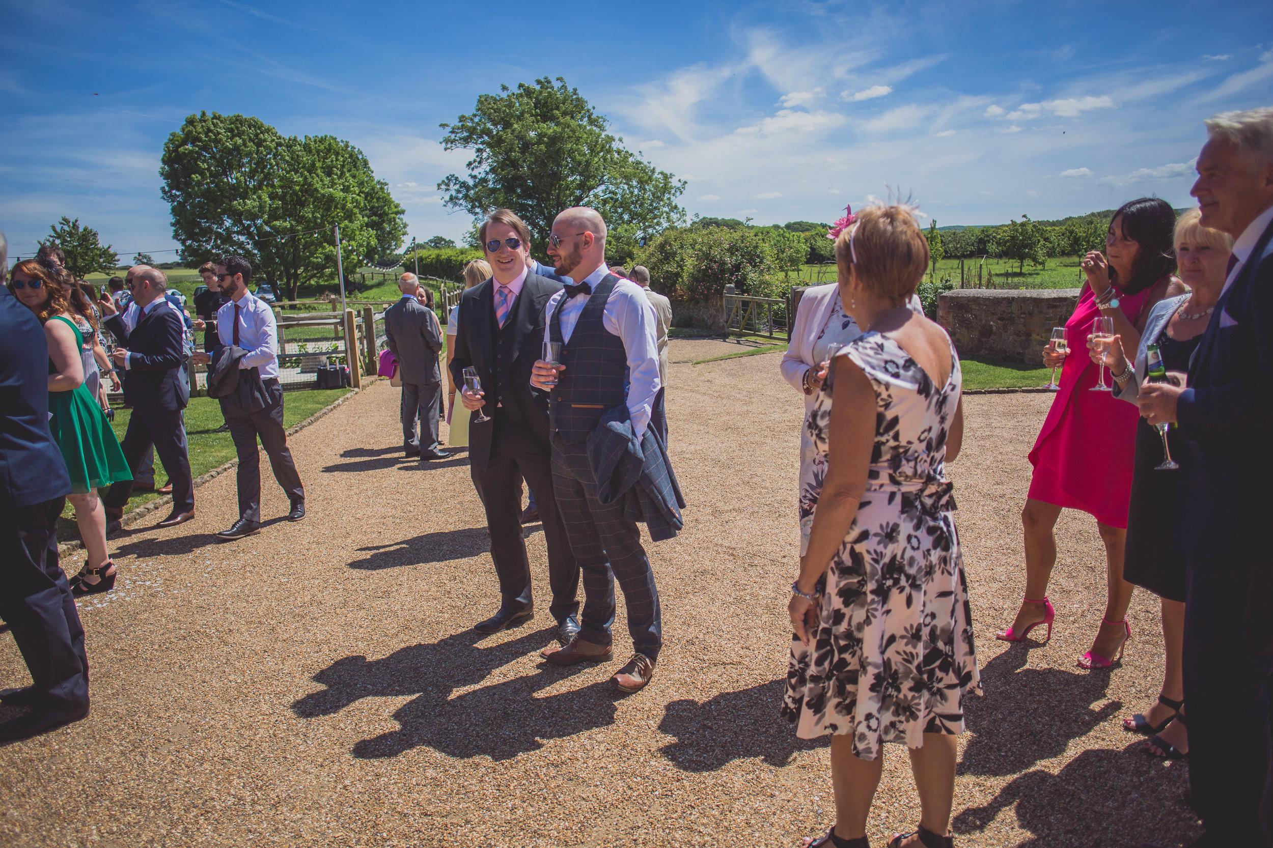 Grittenham Barn female wedding photographers west sussex petworth social-82.jpg