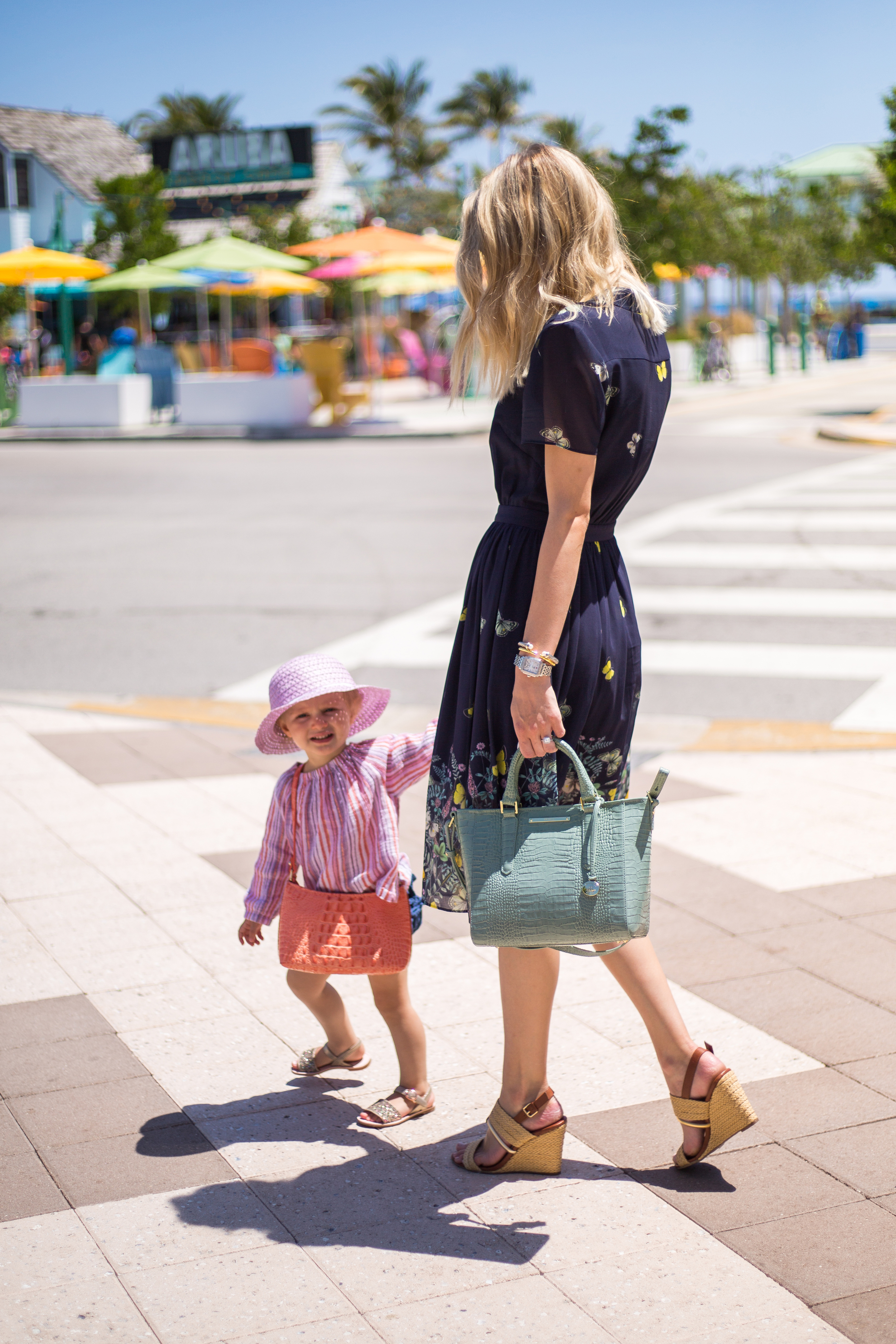 Taylor carries the  Mini Arno  in Cascade Majestic, Maddy carries the  Anytime Mini in Creamsicle Melbourne