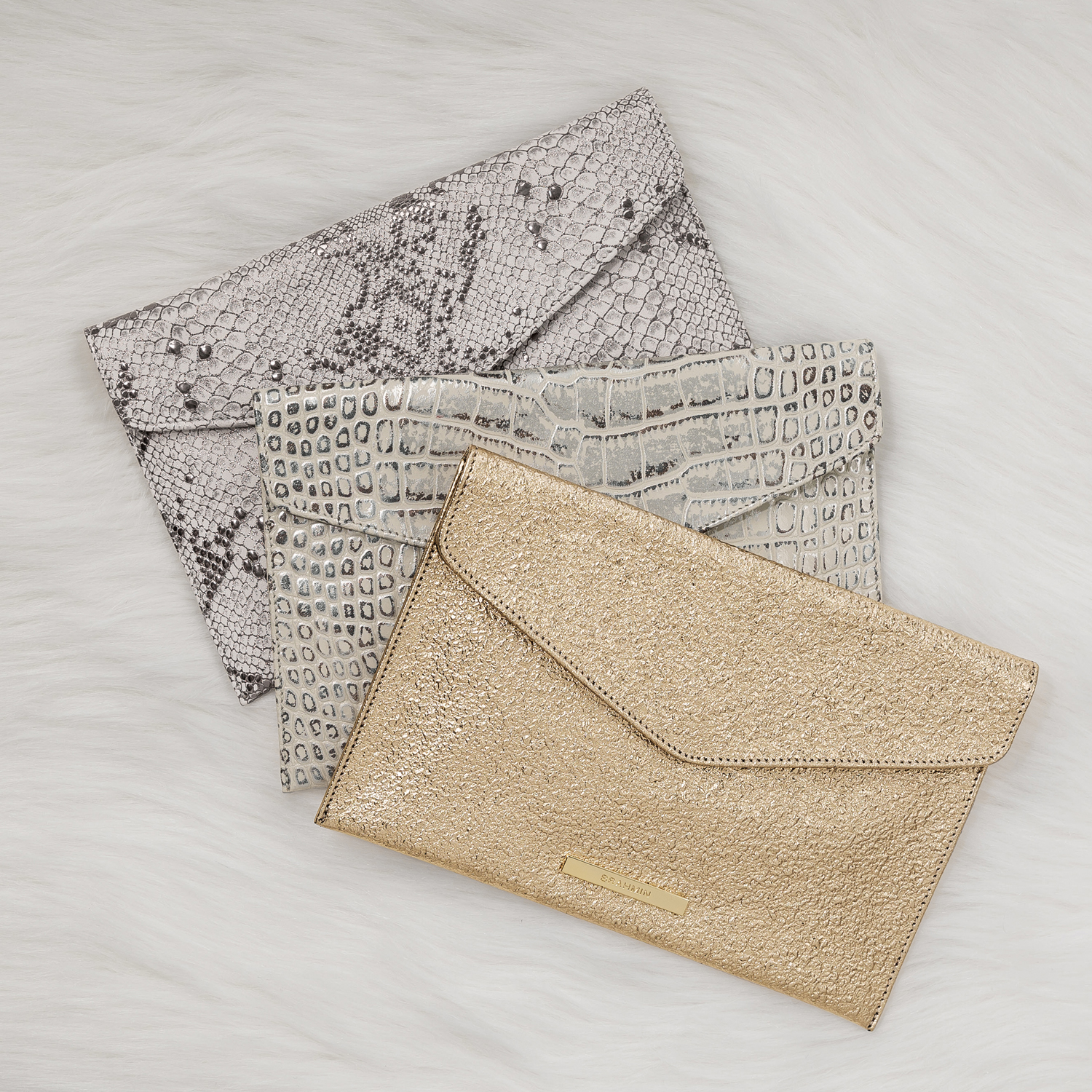 Take Note: Our envelope clutches are sold exclusively at Brahmin boutiques. Don't forget to pick one up!