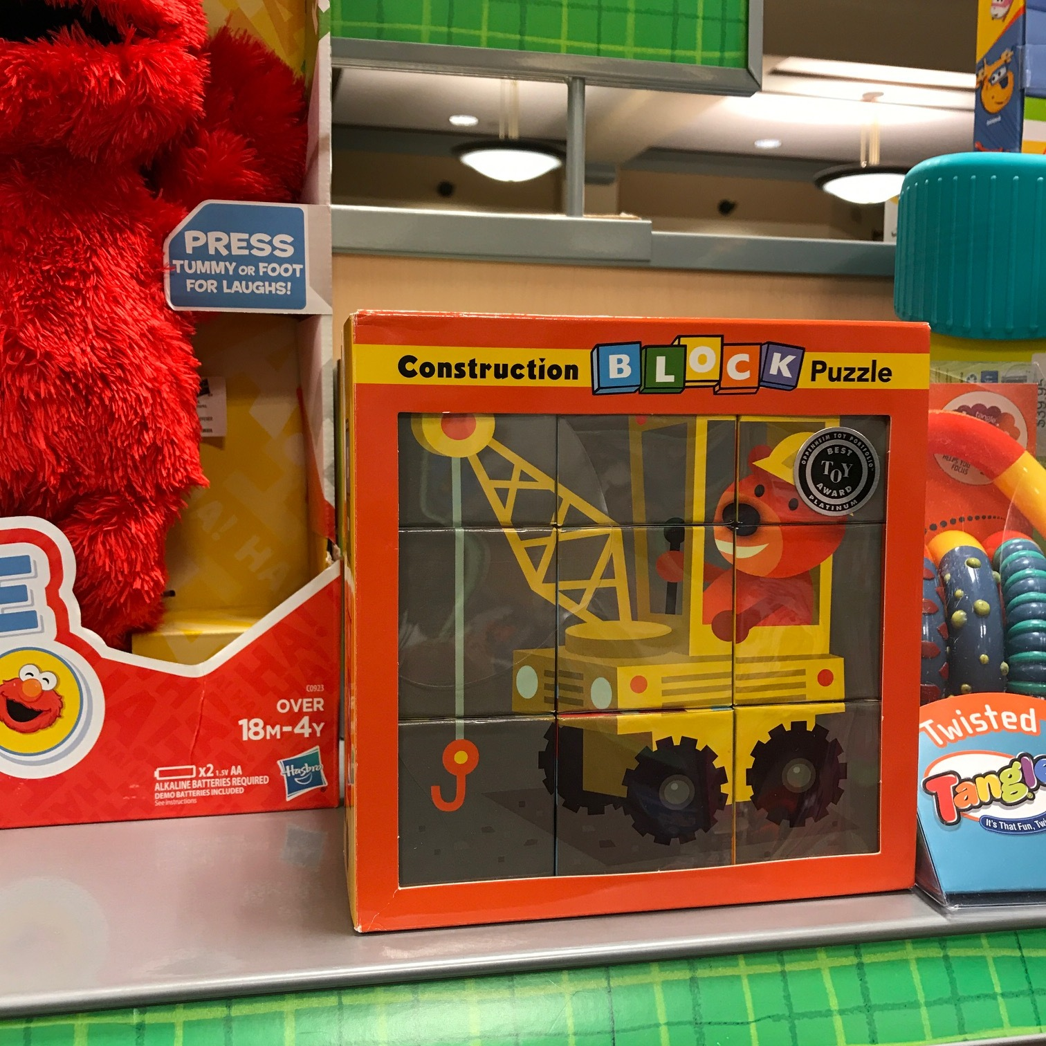 I did this block puzzle for Mud Puppy a few years ago. Nice to see it's still around, and right next to Elmo.