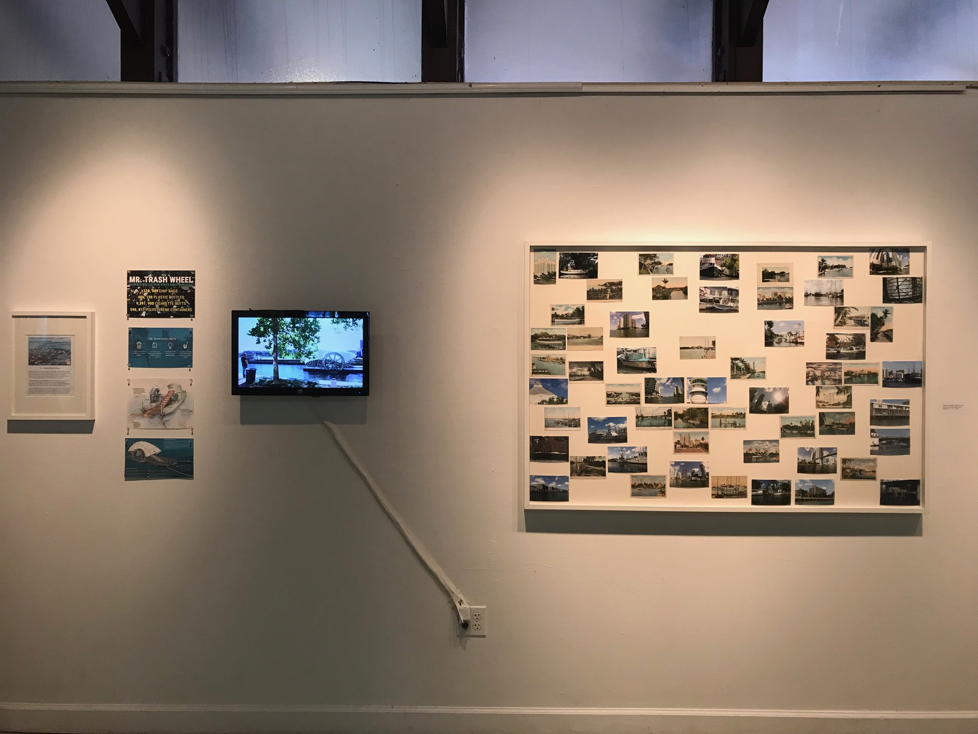 "From left to right: Miami River Show , Gustavo Oviedo     ""Mr.Trash Wheel""  Project  4 videos compilation  Gustavo Oviedo   ""Miami River"" , 2016  eBay items and photo prints (detail)   61"" x 41"