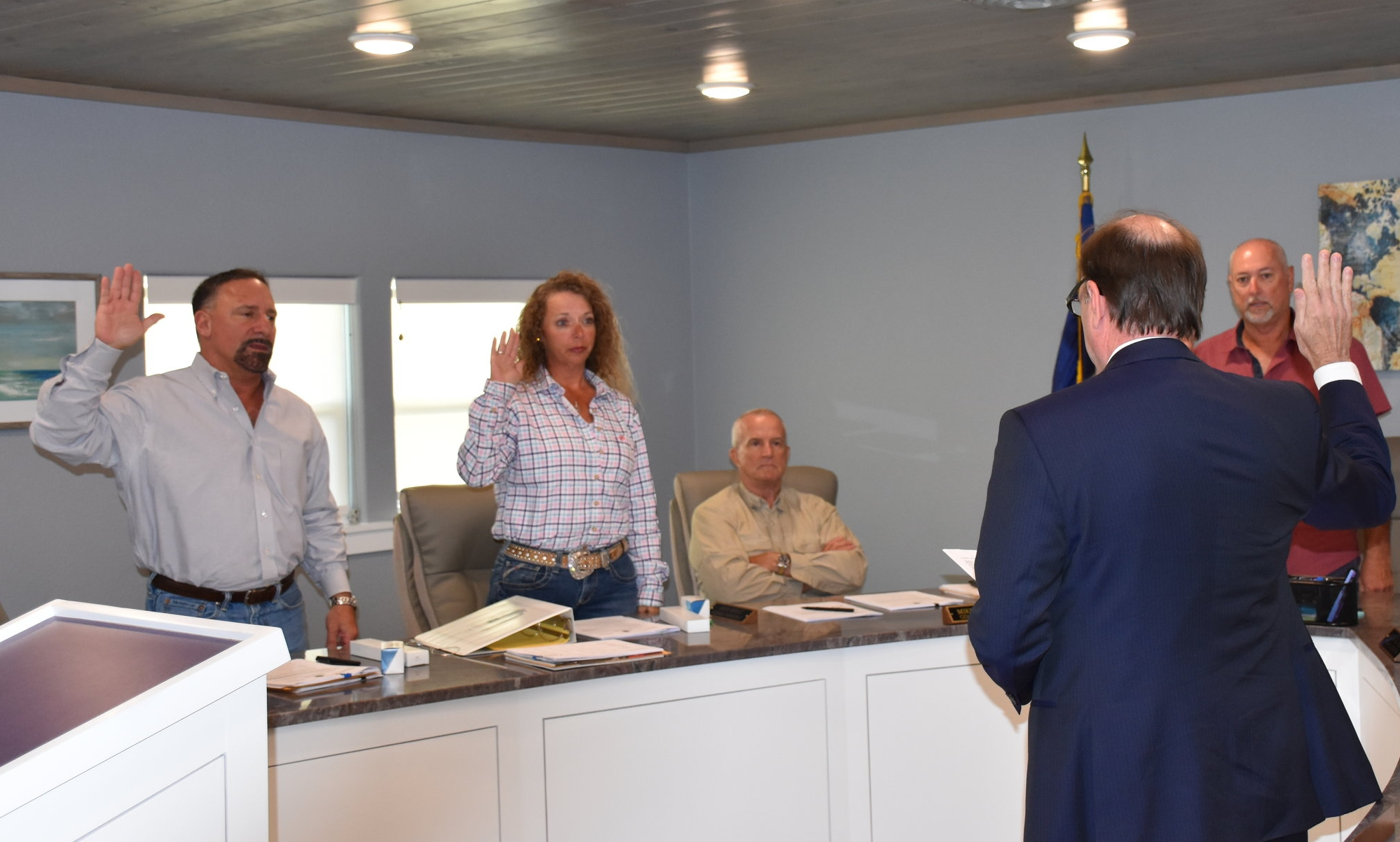City Atty. Alan Petrov swearing-in new Council members, Mike Cassata for Position 1, Shari Wright for Position 2, and Steve Alongis for Mayor; also pictured sitting, Mike Fletcher, Council member, Position 3
